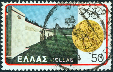 stadia: GREECE - CIRCA 1980: A stamp printed in Greece from the Olympic Games, Moscow. Designs showing Greek stadia issue shows Panathenaic stadium and first Olympic Games medal, circa 1980.