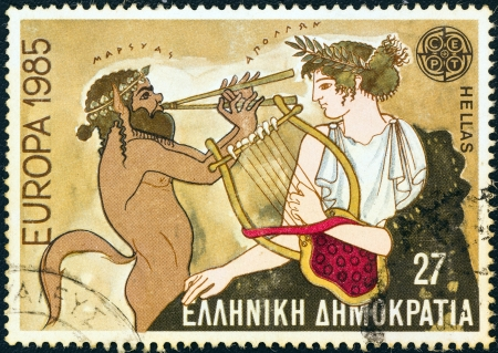 """GREECE - CIRCA 1985: A stamp printed in Greece from the """"Europa"""" issue shows musical contest mosaic between Marsyas and Apollo, circa 1985."""