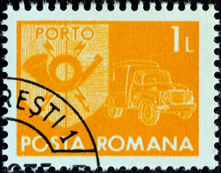 posthorn: ROMANIA - CIRCA 1974: A stamp printed in Romania shows a posthorn and mail van, circa 1974.