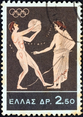 olympiad: GREECE - CIRCA 1964: A stamp printed in Greece from the Olympic Games, Tokyo issue shows Discus throw, circa 1964.