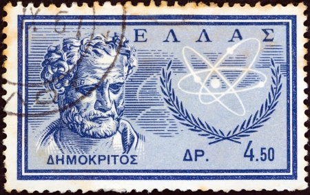 GREECE - CIRCA 1961: A stamp printed in Greece from the Inauguration of Democritus Nuclear Research Centre, Aghia Paraskevi issue shows ancient Greek philosopher Democritus, circa 1961.