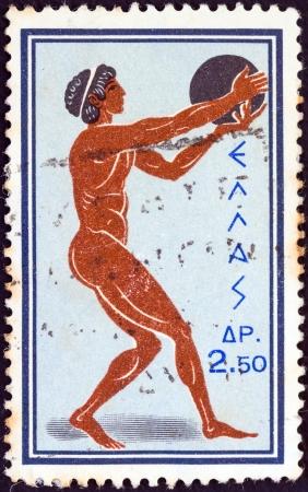 """lanzamiento de disco: GRECIA - CIRCA 1960: Un sello impreso en la Grecia de los """"Juegos Ol�mpicos, Roma"""" cuesti�n muestra Lanzamiento de disco, alrededor de 1960. Editorial"""