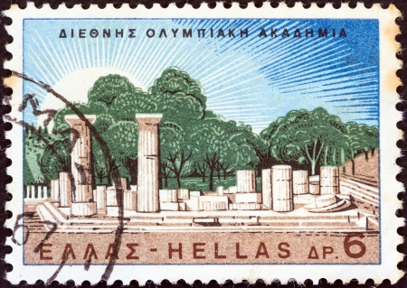 GREECE - CIRCA 1967: A stamp printed in Greece issued for the the inauguration of the International Olympic Academy shows temple of Hera ruins, Olympia, circa 1967.