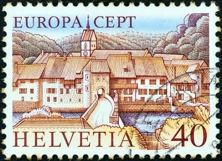 SWITZERLAND - CIRCA 1977: A stamp printed in Switzerland from the Europa issue shows St. Ursanne, circa 1977.  Editorial