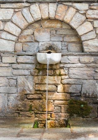 Old traditional drinking fountain in Pelion, Greece photo