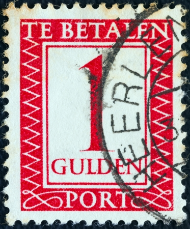 nederlan: NETHERLANDS - CIRCA 1947: A stamp printed in the Netherlands shows its value, circa 1947.