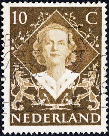 nederlan: NETHERLANDS - CIRCA 1948: A stamp printed in the Netherlands from the coronation issue shows Queen Juliana, circa 1948.  Editorial