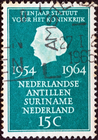 nederlan: NETHERLANDS - CIRCA 1964: A stamp printed in the Netherlands issued for the 10th anniversary of Statute for the Kingdom shows Queen Juliana, circa 1964.