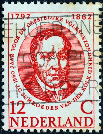 physiologist: NETHERLANDS - CIRCA 1960: A stamp printed in the Netherlands issued for the World Mental Health Year shows Dutch anatomist and physiologist Schroeder van der Kolk (1797-1862), circa 1960.