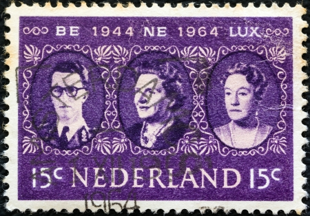 baudouin: NETHERLANDS - CIRCA 1964: A stamp printed in the Netherlands issued for the 20th anniversary of BENELUX shows Baudouin of Belgium, Queen Juliana, Grand Duchess Charlotte, circa 1964.  Editorial