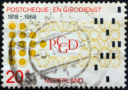 orange nassau: NETHERLANDS - CIRCA 1968: A stamp printed in the Netherlands issued for the 50th anniversary of Netherlands Postal cheque and clearing service shows Financial Automation, circa 1968.  Editorial