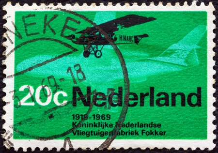 orange nassau: NETHERLANDS - CIRCA 1969: A stamp printed in the Netherlands issued for the 50th anniversary of the founding in 1919 of Royal Dutch Airlines and Fokker factories shows Fokker F.2, circa 1969.