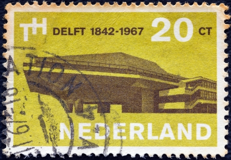 nederlan: NETHERLANDS - CIRCA 1967: A stamp printed in the Netherlands issued for the 125th anniversary of Delft Technological University shows Assembly Hall, circa 1967.
