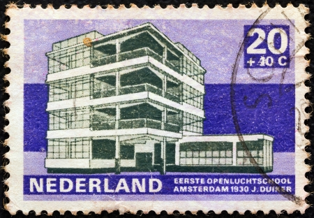 orange nassau: NETHERLANDS - CIRCA 1969: A stamp printed in the Netherlands from the 20th century Dutch architecture issue shows Open Air school, Amsterdam (1930), circa 1969.
