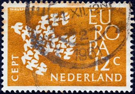 orange nassau: NETHERLANDS - CIRCA 1961: A stamp printed in the Netherlands from the Europa issue shows Europa dove, circa 1961.