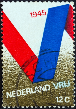 orange nassau: NETHERLANDS - CIRCA 1970: A stamp printed in the Netherlands issued for the 25th anniversary of Liberation shows V Symbol, circa 1970.