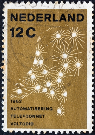 nederlan: NETHERLANDS - CIRCA 1962: A stamp printed in the Netherlands issued for the completion of Netherlands Automatic Telephone System shows diagram of telephone network, circa 1962.