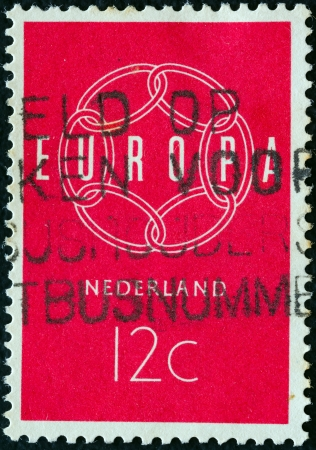 orange nassau: NETHERLANDS - CIRCA 1959: A stamp printed in the Netherlands from the Europa issue shows a chain composition, circa 1959.  Editorial