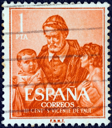 SPAIN - CIRCA 1960: A stamp printed in Spain issued for the 300th death anniversary of St. Vincent de Paul shows St. Vincent de Paul, circa 1960.  Stock Photo - 19309467