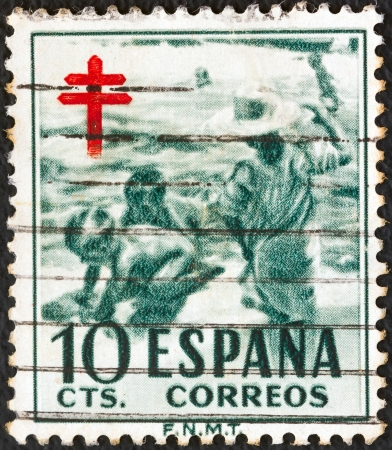 SPAIN - CIRCA 1951: A stamp printed in Spain from the Anti-tubercul osis Fund issue shows children on beach, circa 1951.