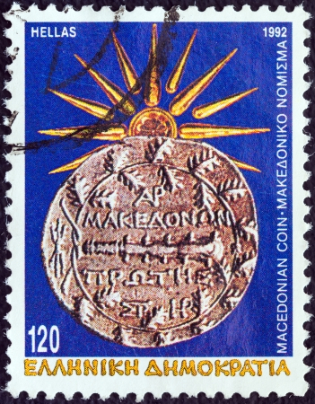 GREECE - CIRCA 1992: A stamp printed in Greece from the Macedonia issue shows ancient Macedonian tetradrachm coin and the Vergina Sun, circa 1992.