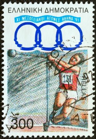 """lancer marteau: GR�CE - CIRCA 1991: Un timbre imprim� en Gr�ce de la """"11�me Jeux M�diterran�ens, Ath�nes"""" question montre lancer du marteau, circa 1991."""