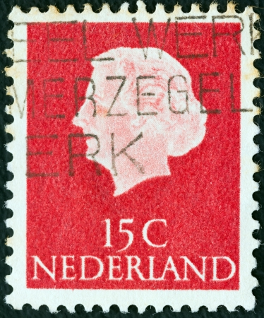 stempeln: NETHERLANDS - CIRCA 1953: A stamp printed in the Netherlands shows Queen Juliana, circa 1953.  Editorial