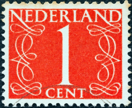 nederlan: NETHERLANDS - CIRCA 1946: A stamp printed in the Netherlands shows its value of 1 cent, circa 1946.  Editorial