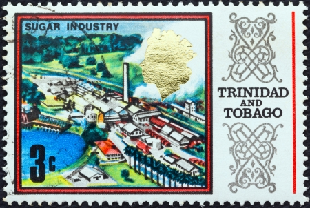TRINIDAD AND TOBAGO - CIRCA 1969: A stamp printed in Trinidad and Tobago shows a Sugar refinery, circa 1969.