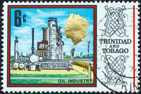 TRINIDAD AND TOBAGO - CIRCA 1969: A stamp printed in Trinidad and Tobago shows an Oil refinery, circa 1969.  Stock Photo - 19599238