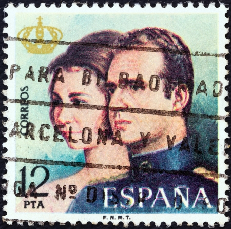 proclamation: SPAIN - CIRCA 1975: A stamp printed in Spain from the Proclamation of King Juan Carlos I issue shows King Juan Carlos and Queen Sophia, circa 1975.  Editorial
