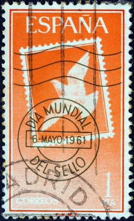 stempeln: SPAIN - CIRCA 1961: A stamp printed in Spain from the World Stamp Day issue shows Stamp and Postmark, circa 1961.