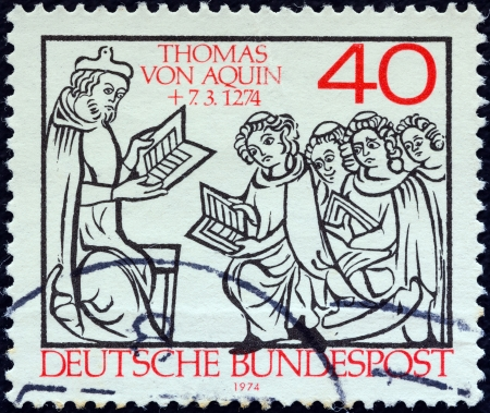 bundes: GERMANY - CIRCA 1974: A stamp printed in Germany issued for the 700th death anniversary of St. Thomas Aquinas shows St. Thomas teaching pupils, circa 1974.