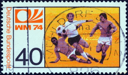 melee: GERMANY - CIRCA 1974: A stamp printed in Germany from the World Cup Football Championship issue shows midfield melee, circa 1974.  Editorial