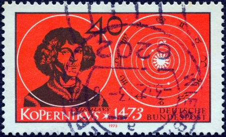 bundes: GERMANY - CIRCA 1973: A stamp printed in Germany issued for the 500th birth anniversary of Copernicus shows astronomer Nicolaus Copernicus and his vision of universe, circa 1973.
