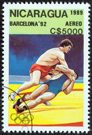 greco roman: NICARAGUA - CIRCA 1989: A stamp printed in Nicaragua from the Olympic Games, Barcelona 1992 issue shows Wrestling, circa 1989.