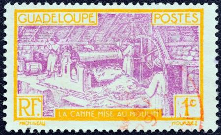 GUADELOUPE - CIRCA 1928: A stamp printed in France shows Sugar Refinery, circa 1928.
