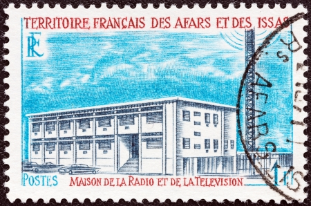 somalis: FRENCH TERRITORY OF AFARS AND ISSAS - CIRCA 1968: A stamp printed in France from the Buildings and Landmarks issue shows TV and Radio Broadcasting Station, circa 1968.