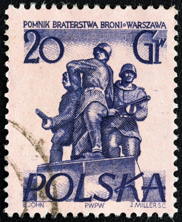 polska monument: POLAND - CIRCA 1955: A stamp printed in Poland from the Warsaw Monuments issue shows Brotherhood in Arms, circa 1955.