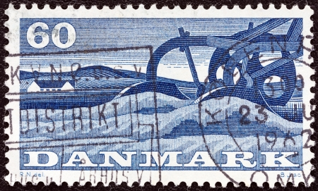 DENMARK - CIRCA 1960: A stamp printed in Denmark from the 1st Danish Food Fair issue shows a plough, circa 1960.