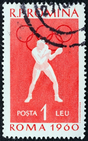 stempeln: ROMANIA - CIRCA 1960: A stamp printed in Romania from the Olympic Games, Rome 2nd issue shows Boxing, circa 1960.  Editorial
