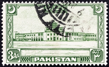 jinnah: PAKISTAN - CIRCA 1949: A stamp printed in Pakistan shows Karachi Airport, circa 1949.
