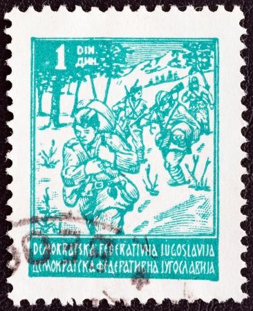yugoslavia: YUGOSLAVIA - CIRCA 1945: A stamp printed in Yugoslavia shows Partisans, circa 1945.
