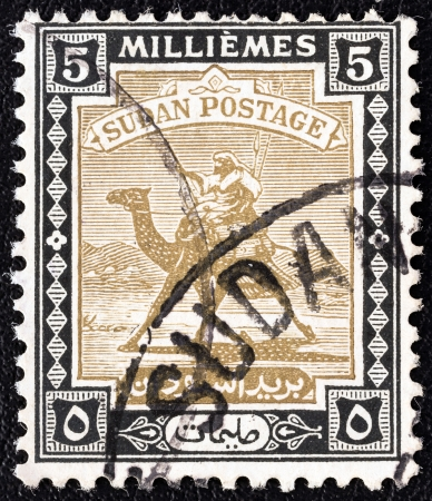 postman of the desert: SUDAN - CIRCA 1921: A stamp printed in Sudan shows Arab Postman on camel, circa 1921.