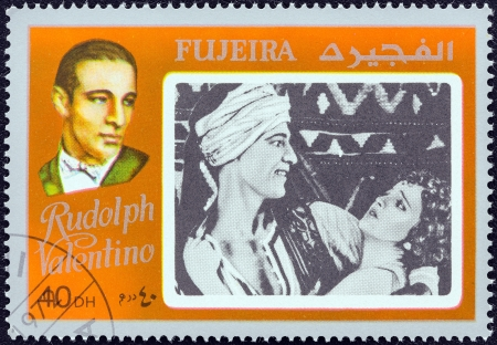 FUJAIRAH EMIRATE - CIRCA 1972: A stamp printed in United Arab Emirates from the Deceased movie actors and actresses issue shows Rudolph Valentino, circa 1972.