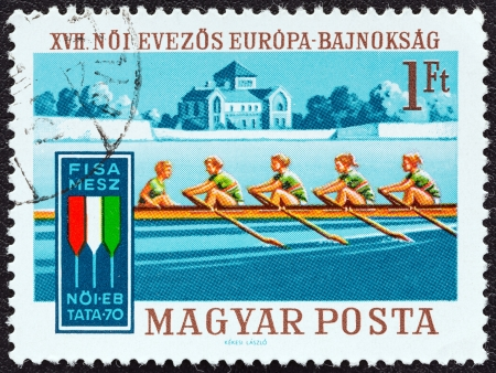 magyar: HUNGARY - CIRCA 1970: A stamp printed in Hungary issued for the 17th European Womens Rowing Championships, Lake Tata, shows Rowing Four with coxswain, circa 1970.