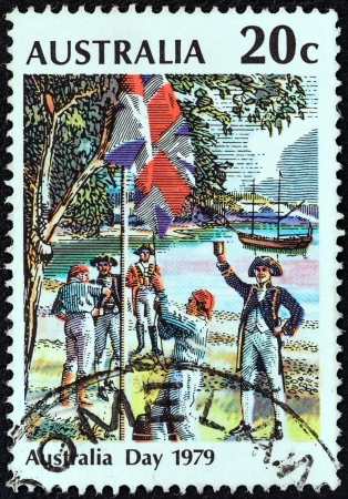 AUSTRALIA - CIRCA 1979: A stamp printed in Australia from the Australia Day issue shows Raising the Flag, Sydney Cove, 26 January 1788, circa 1979.