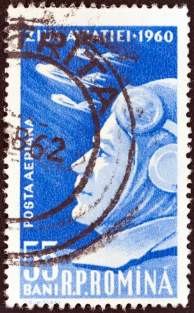 mig: ROMANIA - CIRCA 1960: A stamp printed in Romania from the 50th anniversary of 1st flight by Aurel Vlaicu and Aviation Day issue shows Pilot and Mikoyan Gurevich MiG-17 Jet Fighters, circa 1960.