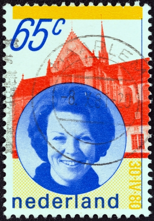 regnant: NETHERLANDS - CIRCA 1980: A stamp printed in the Netherlands issued for the installation of Queen Beatrix shows Queen Beatrix and New Church, Amsterdam, circa 1980.  Editorial