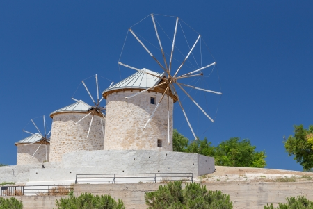 Traditional windmills in Alacati, Izmir province, Turkey photo